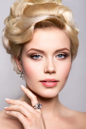 Portrait of beautiful bride. Wedding hairstyle. Bright make up. photo