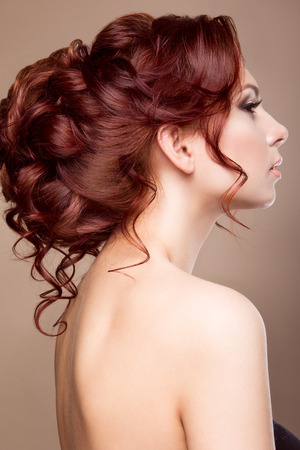hair style: Beautiful bride with fashion hairstyle. Red hair.