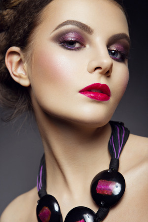 red lip: Close-up portrait of beautiful woman with bright make-up and pink lips Stock Photo