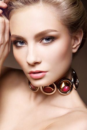 Glamour portrait of beautiful woman model with fresh daily makeup and romantic wavy hairstyle. Fashion shiny highlighter on skin, sexy gloss lips make-up and dark eyebrows Stock Photo