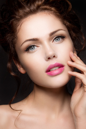 Close-up portrait of beautiful woman with bright make-up and pink lips Stock Photo