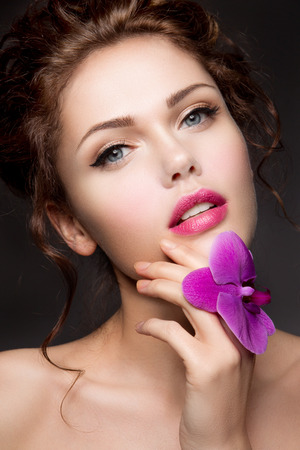 beauty: Close-up portrait of beautiful woman with bright make-up and pink lips Stock Photo