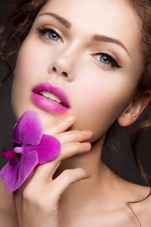 gorgeous girl: Close-up portrait of beautiful woman with bright make-up Stock Photo