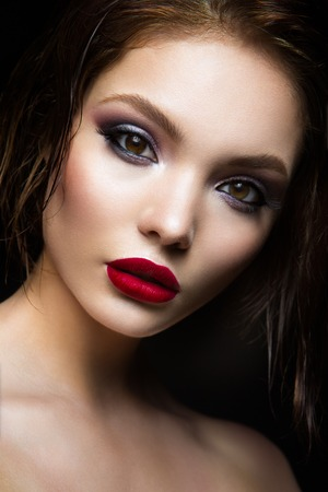 retro: Beautiful young model with red lips and dark makeap
