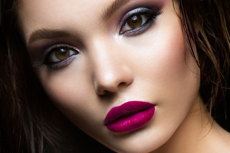 eye red: Beautiful young model with pink lips and dark makeap