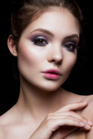 pink lips: Close-up portrait of beautiful woman with bright make-up. Pink lips. Stock Photo