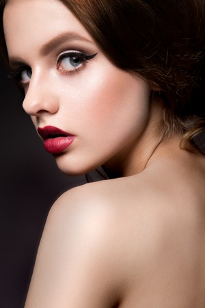 sexual girl: Close-up portrait of beautiful woman with bright make-up. Curly Hair