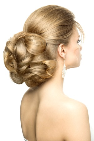 Portrait of the bride with beautiful hairstyle on white background. Bright make up.