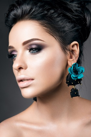 woman shadow: Portrait of beautiful young woman with black hair and bright make-up, with accessories