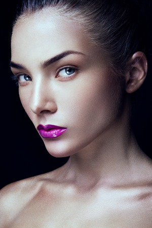 gloss: Close-up portrait of beautiful woman with bright make-up and pink lips Stock Photo