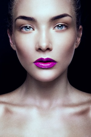 Pink lips: Close-up portrait of beautiful woman with bright make-up and pink lips Stock Photo