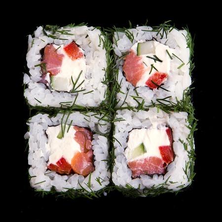 sushi: Japanese seafood sushi set on black background