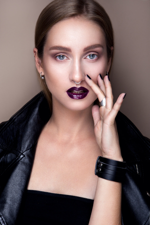 beautiful vampire: Portrait of gothic girl with blue eyes in dark clothes. Dark Lips. Stock Photo