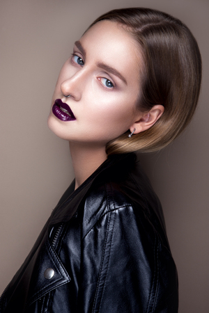 glamour girl: Portrait of gothic girl with blue eyes in dark clothes. Dark Lips. Stock Photo