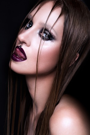 gothic woman: Portrait of gothic girl with blue eyes in dark clothes. Dark Lips. Stock Photo