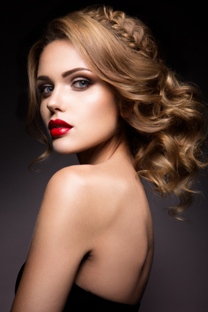 fashion portrait: Close-up portrait of beautiful woman with bright make-up and red lips