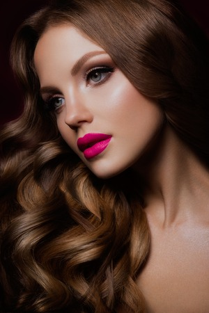 woman hairstyle: Close-up portrait of beautiful woman with bright make-up and hairstyle.