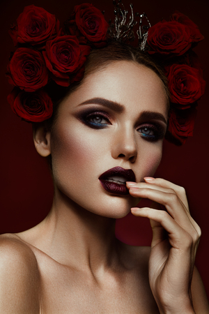 female portrait: Close-up portrait of beautiful woman with dark make-up and hairstyle. Stock Photo