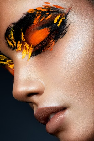 bright lipstick: Beauty fashion model girl with dark bright orange make-up. Close up portret.