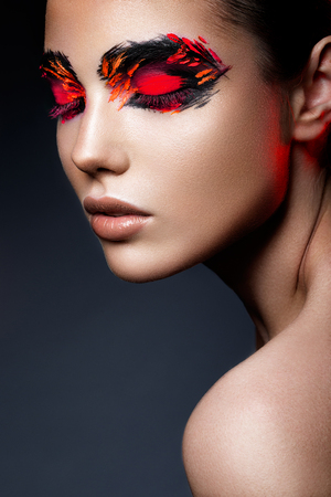 female beauty: Beauty fashion model girl with dark bright orange make-up. Close up portret.