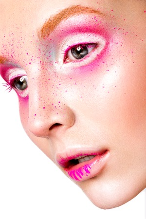 Close-up portrait of young beautiful girl with pink make-up