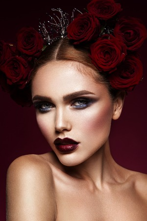 Close-up portrait of beautiful woman with dark make-up and hairstyle. 版權商用圖片