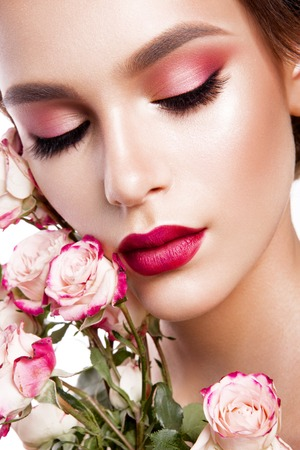 red lips: Portrait of young beautiful woman with stylish make-up and colorful roses around her face