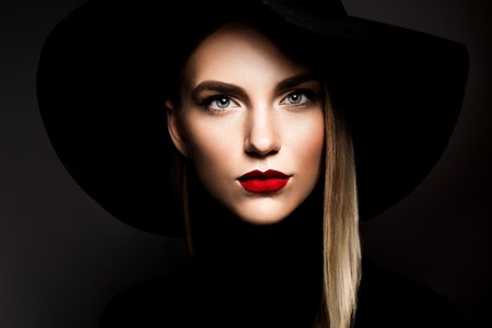 gloss: Woman with red lips and black hat