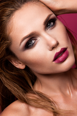 make up model: Glamour portrait of beautiful woman model with fresh makeup and romantic wavy hairstyle. Stock Photo