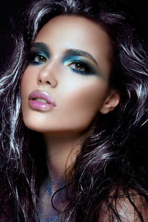 blue face: Beautyful girl with blue glitter on her face Stock Photo