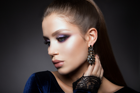 blue face: Beautyful girl with bright make up Stock Photo
