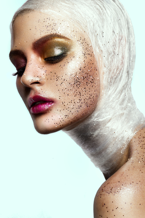 light to dark: Close up of woman face with glitter on face