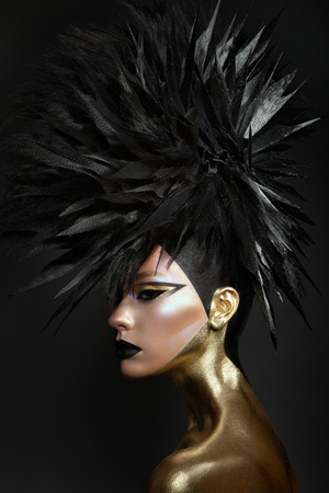 Studio beauty portrait of young woman with black graphic makeup 免版税图像