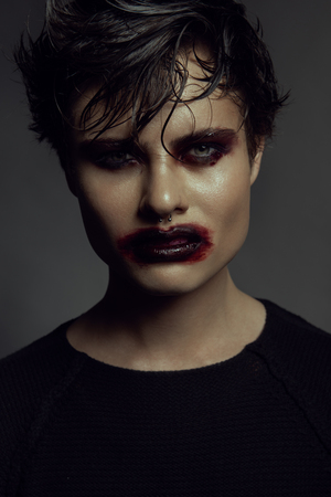 Fashion portrait of man. Angry emotion on a face