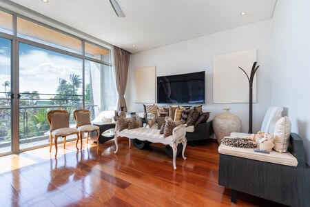 Wooden flooring, sofa and television in pool villa, house, home, condo and apartment Фото со стока
