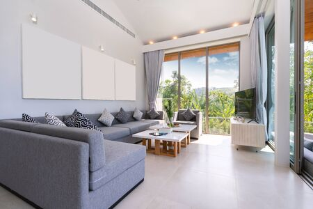 Interior design in villa, house, home, condo and apartment feature sofa, middle tale and television in living room with view Stockfoto