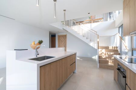 Interior design of pool villa, house, home, condo and apartment feature round stool, kitchen counter and kitchenette