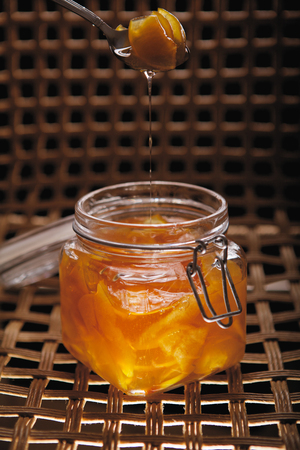sugary: Homemade quince jam with a spoon of sugary syrup Stock Photo