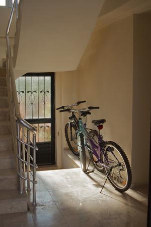 doorway: Two bicycles in the doorway of an apartment block Stock Photo