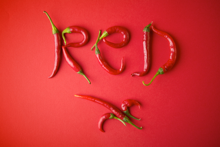 piquancy: Word Red shaped with red chilli pepper