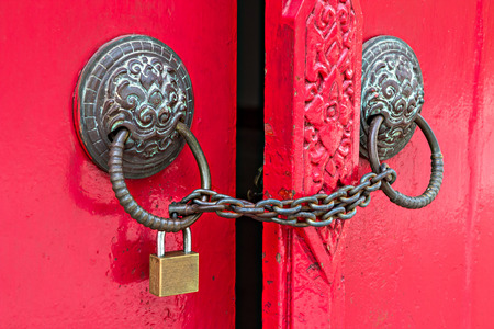 locked door by chain and padlock photo