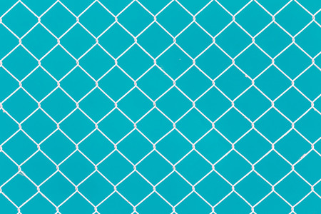 meshed: White wire fence on green background Stock Photo