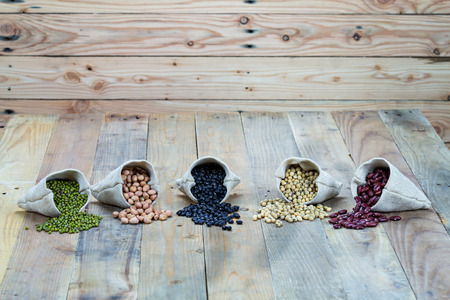 Beans on vintage wooden boards photo