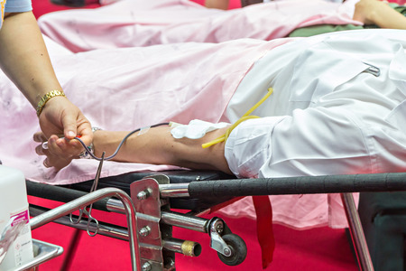 transfused: Blood Donors Making Donation In Hospital, focus at center