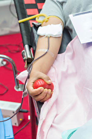 transfused: Blood Donor Making Donation with a bouncy ball holding in hand