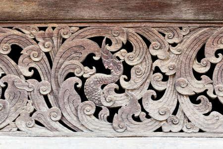 decorative wall: Ancient Naga wood carving in thai temple