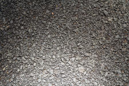 asphalt paving: background and texture of rough asphalt