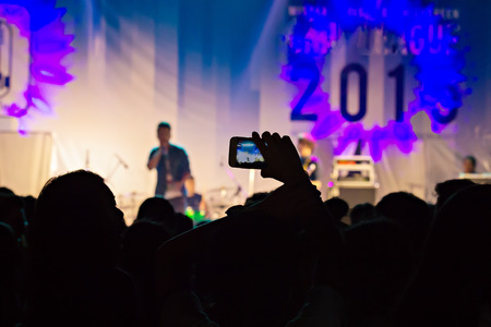 vdo: Silhouette of person take a video on mobile phone at a music festival.