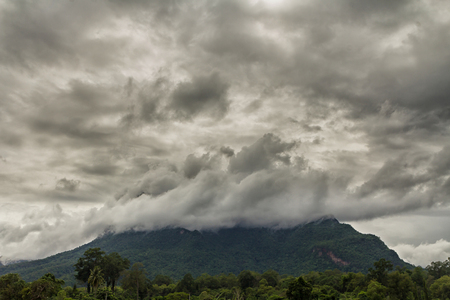 stormy clouds: Stormy clouds cover the mountain Stock Photo