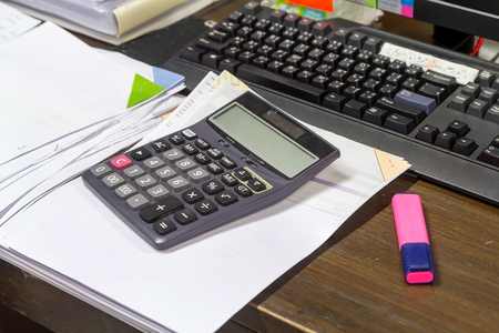 staple: Calculator, staple and business documents stack on table